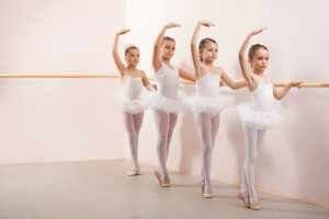 Group of six little ballerinas posing together with back to camera. They are good friend and amazing dance performers